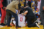 April 30, 2019; Oakland, CA, USA; Houston Rockets guard James Harden (13) is looked at after an injury against the Golden State Warriors during the first quarter in game two of the second round of the 2019 NBA Playoffs at Oracle Arena.