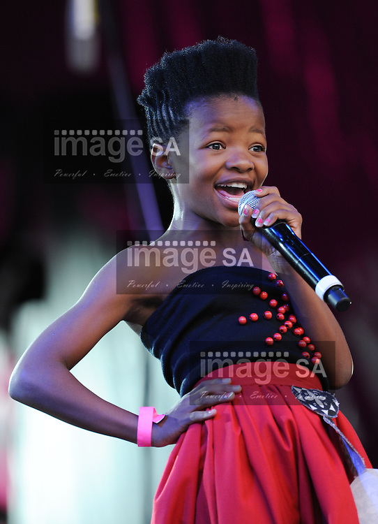 "BOTLHALE BOIKANYO (12) performs a poem in honor of Nelson Mandela during the City of Cape Town hosted concert at the 45000 seater Cape Town Stadium called ""Nelson Mandela - A life Celebrated"". Nelson Mandela was the first democratically elected president of South Africa."