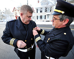 "EMS honor guard members put final touches on their uniforms. A funeral service and procession is held for longtime Bethlehem Emergency Medical Service employee William ""Billy"" Guth Jr. on March 21, 2015, in Bethlehem. (Chris Post 