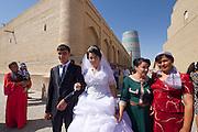 Uzbekistan, Khiva, Ichon-Qala.<br /> Kalta Minor Minaret. Wedding couple.