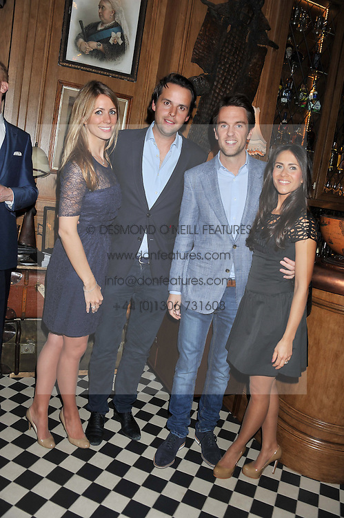 Left to right, ANNEKE VON TROTHA TAYLOR, CHARLIE GILKES, DUNCAN STIRLING and his wife ZOE at a party to celebrate the launch Mr Fogg's, 15 Bruton Lane, London W1 on 21st May 2013.