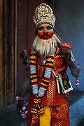 Boy dressed as Hanuman, the monkey god, in Hinduism, at Pushkar Fair.