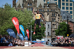 © Licensed to London News Pictures . 17/05/2014 . Manchester , UK . Long jumper IGNISIOUS GAISAH from the Netherlands . The Great City Games in Manchester , with athletics on a track along Deansgate and Pole Vault and Long Jump in Albert Square . Photo credit : Joel Goodman/LNP