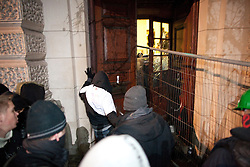 © under license to London News Pictures. 9/12/2010. Protesters break open the doors of the Treasury building in Whitehall. On the day that MPs vote on tuition fees, 1000s demonstrated in London against a proposed rise in fees and cuts in support. Picture caption should read Joel Goodman/London News Pictures