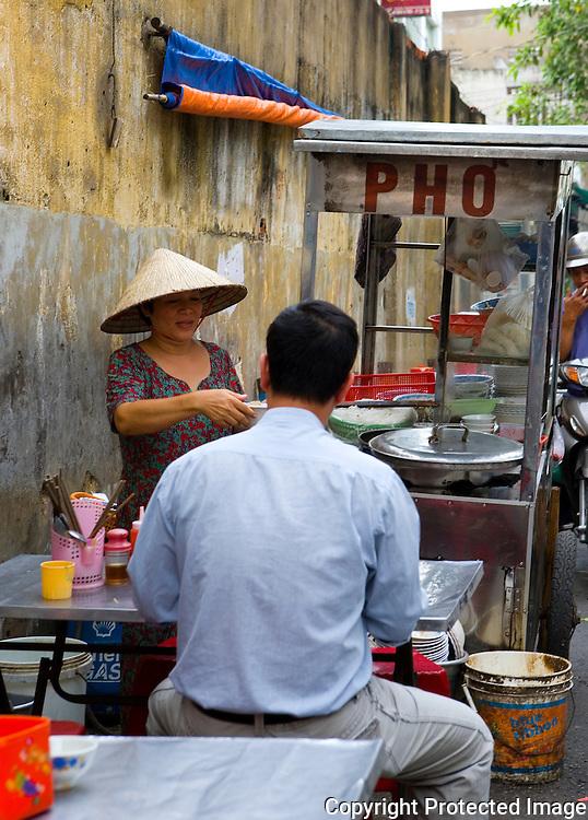an alleyway noodle vendor, Ho Chi Minh City, Vietnam
