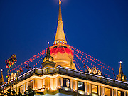 18 NOVEMBER 2015 - BANGKOK, THAILAND: The chedi of Wat Saket at the start of the temple's annual fair. Wat Saket is on a man-made hill in the historic section of Bangkok. The temple has golden spire that is 260 feet high which was the highest point in Bangkok for more than 100 years. The temple construction began in the 1800s in the reign of King Rama III and was completed in the reign of King Rama IV. The annual temple fair is held on the 12th lunar month, for nine days around the November full moon. During the fair a red cloth (reminiscent of a monk's robe) is placed around the Golden Mount while the temple grounds hosts Thai traditional theatre, food stalls and traditional shows.      PHOTO BY JACK KURTZ