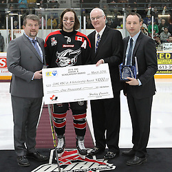 TRENTON, - Apr 15, 2016 -  Ontario Junior Hockey League game action between Trenton Golden Hawks and the Georgetown Raiders. Game 1 of the Buckland Cup Championship Series. At the Duncan Memorial Gardens, ON. 2015-2016 OJHL Awards presentation for Scholastic Player of the year Andrew Court. Presented by OJHL Chairman of the Board of Governors Scott McCrory.Gary Moroney Vice Chairman of the Board Ontario Hockey Association and OJHL Commissioner Marty Savoy.<br /> (Photo by Tim Bates / OJHL Images)