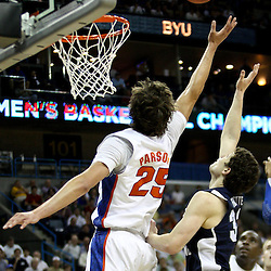 Mar 24, 2011; New Orleans, LA; Brigham Young Cougars guard Jimmer Fredette (32) shoots over Florida Gators forward Chandler Parsons (25) during the first half of the semifinals of the southeast regional of the 2011 NCAA men's basketball tournament at New Orleans Arena.  Mandatory Credit: Derick E. Hingle