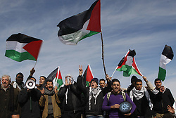 Palestinians along with Israeli and foreign activists wave Palestinian flags while shouting slogans during a gathering at an outpost named Bab al-Shams ( Gate of the Sun )  between Jerusalem and the Jewish settlement of Maale Adumim in the Israeli-occupied West Bank, in an area where Israel has vowed to build new settler homes, on Jan. 12, 2013. The Israeli occupation administration gave Palestinian activists an ultimatum to quit the protest camp in part of the West Bank, but hours after the deadline passed, there was no sign of any Israeli move to evict the protesters, January 12, 2013. Photo by Imago / i-Images...UK ONLY