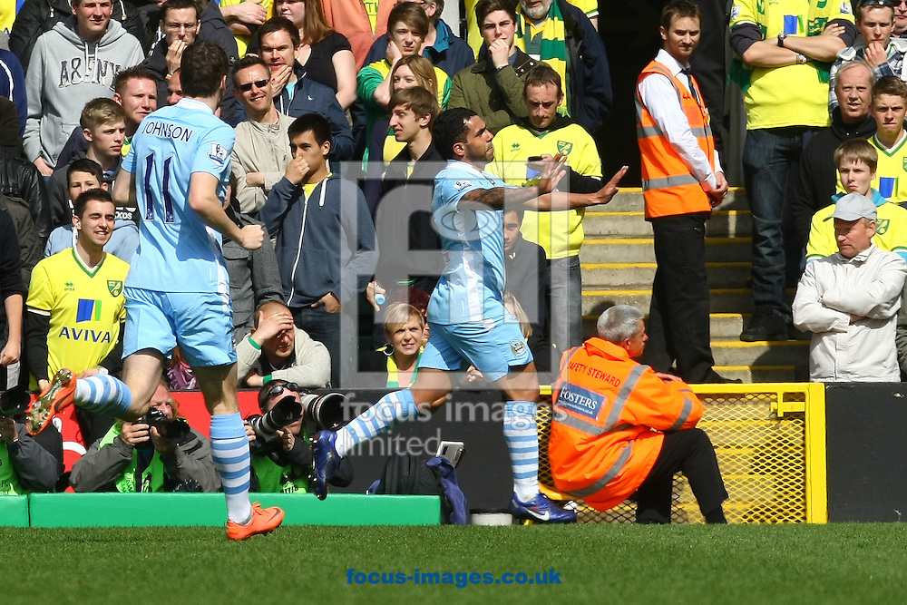 Picture by Paul Chesterton/Focus Images Ltd.  07904 640267.14/04/12.Carlos Tévez of Man City completes his Hat Trick and celebrates during the Barclays Premier League match at Carrow Road Stadium, Norwich.