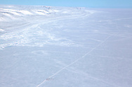 Canadian Rangers snowmobile patrol on icepack off Devon Island, Nunavut, during Nunalivut 2012 sovereignty exercise by Canadian Forces in arctic Canada.