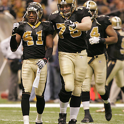 Jan 24, 2010; New Orleans, LA, USA; New Orleans Saints safety Roman Harper (41) and offensive tackle Jonathan Stinchcomb (78) celebrate after the Saints recovered a Minnesota Vikings fumble during the second quarter of the 2010 NFC Championship game at the Louisiana Superdome. Mandatory Credit: Derick E. Hingle-US PRESSWIRE