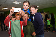 Forest Green Rovers Christian Doidge(9) has a photo with some young supporters during the Pre-Season Friendly match between Forest Green Rovers and Bristol Rovers at the New Lawn, Forest Green, United Kingdom on 22 July 2017. Photo by Shane Healey.
