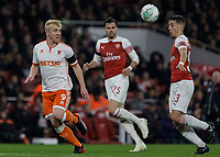 Football - 2018 / 2019 EFL Carabao (League) Cup - Fourth Round: Arsenal vs. Blackpool<br /> <br /> Mark Cullen (Blackpool FC) watches the flight of the ball as Julio Pleguezuelo (Arsenal FC)  mis judges it at The Emirates.<br /> <br /> COLORSPORT/DANIEL BEARHAM