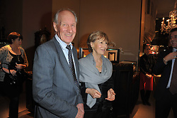 CHARLES & PATTI PALMER-TOMKINSON at a party to celebrate the launch of Simon Sebag-Montefiore's new book - 'Jerusalem: The Biography' held at Asprey, 167 New Bond Street, London on 26th January 2011.