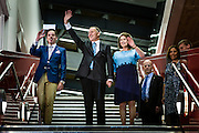 A triumphant John Key, accompanied by his wife Bronagh and son Max, arrives at the National party celebrations at the Viaduct Event Centre. <br /> 2014 New Zealand General Election night photography commissioned by The NZ Listener magazine.