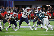 New England Patriots tight end Rob Gronkowski (87) and New England Patriots offensive tackle Cameron Fleming (71) block Philadelphia Eagles defensive end Brandon Graham (55) as he rushes and causes a strip sack fumble on a play that gives the Eagles the ball and sets up a late fourth quarter field goal during the 2018 NFL Super Bowl LII football game against the New England Patriots on Sunday, Feb. 4, 2018 in Minneapolis. The Eagles won the game 41-33. (©Paul Anthony Spinelli)