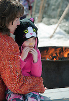 It doesn't get much better for Emily Hansen as she enjoys her smore cooked over the open firepit and a hug from mom Beth Hansen during Prescott Farm's 2nd annual Winter Fest on Saturday afternoon.  (Karen Bobotas/for the Laconia Daily Sun)