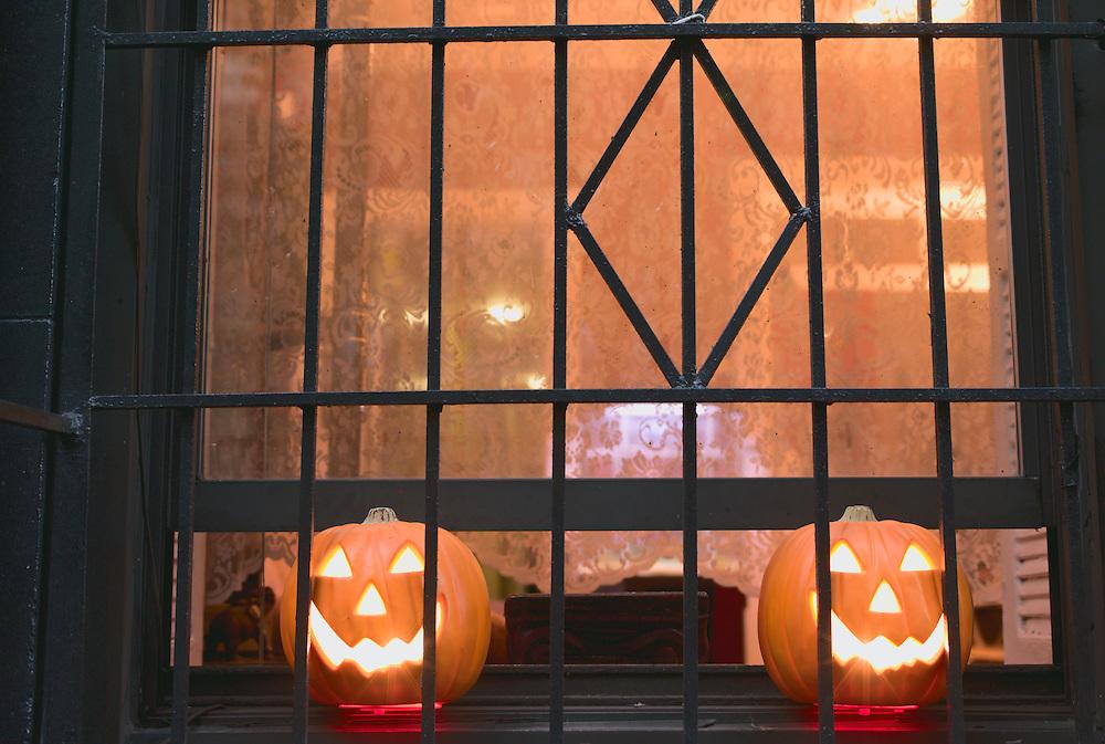 Plastic jack-o'-lanterns in window.