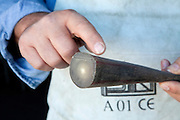 """Avigliano (PZ), 04-10-2010 ITALY - Vito Aquila, artigiano di Balestre. Il coltello di Avigliano, comunemente conosciuto come """"balestra"""", impreziosito con decorazioni in argento e ottone che le conferivano un certo valore non solo artistico,ha identificato per tutto l'Ottocento e parte del Novecento il carattere fiero e risoluto del popolo aviglianese, come attestato in una lunga casistica di riscontri documentari. La """"balestra"""" è un'arma a tutti gli effetti, ed è già considerata -nell'ambito delle manifatture di ferro - oggetto di pregio. Per l'approvvigionamento dell'argento e dell'ottone destinati alla decorazione del manico del coltello gli armieri si rivolgevano agli orefici o agli ottonari. La """"balestra"""" era un'arma del popolo, pronta ad essere impiegata, a seconda delle circostanze, per la difesa o l'offesa tanto dagli uomini quanto dalle donne. Queste, la ricevevano come regalo di fidanzamento dal rispettivo promesso sposo per meglio difendere il proprio onore, perpetrando un'usanza molto sentita almeno fino ai primi decenni del '900..Nella Foto: Corno di bufalo utilizzato per il manico della balestra."""