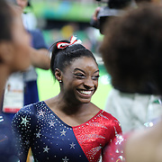 Gymnastics - Olympics: Day 2   Simone Biles #391 of the United States after performing her routine on the Balance Beam during the Artistic Gymnastics Women's Team Qualification round at the Rio Olympic Arena on August 7, 2016 in Rio de Janeiro, Brazil. (Photo by Tim Clayton/Corbis via Getty Images)