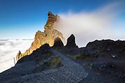 Cloud crashing in a mountain peak