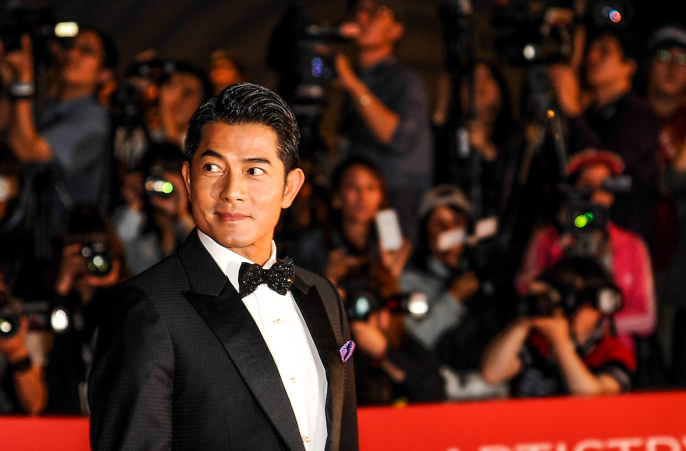 Aaron Kwok arrives at the opening ceremony of the Busan International Film Festival. Kwok was the co-host of the ceremony and stars in the film Silent Witness which is being screened at the festival.