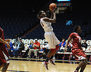 """Ole Miss' Pa'Sonna Hope (15) shoots as Arkansas' Quistelle Williams (24) defends at the C.M. """"Tad"""" Smith Coliseum in Oxford, Miss. on Thursday, January 12, 2012."""