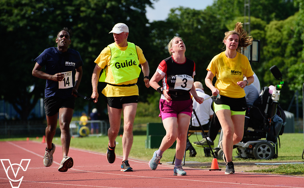 Metro Blind Sport's 2017 Athletics Open held at Mile End Stadium.  5000m.  From left, Competitor #14 with guide runner and Lynn Cox with guide runner<br /> <br /> Picture: Chris Vaughan Photography for Metro Blind Sport<br /> Date: June 17, 2017