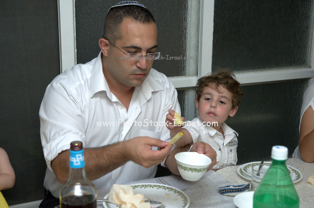 Jewish Rosh Hashana ceremony apple dipped in honey