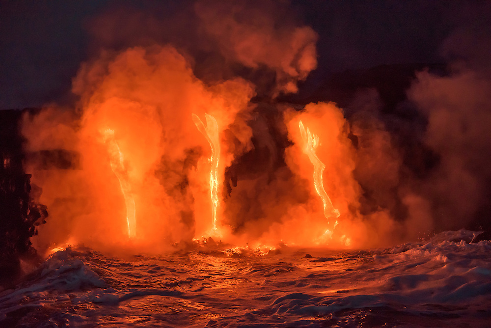 Lava from Pu'u O'o eruption flowing into ocean on the Kalapana coast, Hawaii Volcanoes National Park, Big Island of Hawaii.