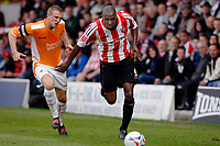 Photo: Daniel Hambury.<br />Brentford v Blackpool. Coca Cola League 1. 17/04/2006.<br />Brentford's Lloyd Owusu gets away from Blackpool's Peter Clarke.