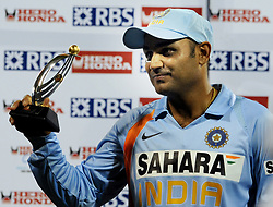 India's Virender Sehwag holds a trophy following the Fourth One Day International at M Chinnaswamy Stadium, Bangalore, India .
