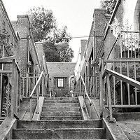 Awkwardly built into the hillside, this apartment complex on Sunset blvd in Echo Park is a labrynth of stairs, guardrails, and porches.