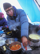 Anna Siebelink cooks dinner inside the tent below Triple Divide pass as howling winds prevent the group from ventureing outside during their 7 day trek across the Sierra High Route