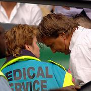 NLD/Rotterdam/20060507 - Finale competitie 2005/2006 Gatorade cup Ajax - PSV, slachtoffer met een bloedende hoofdwond op de tribune na geraakt te zijn met een steen