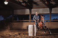 David Lawson, rodeo barrel racing on an American Quarter Horse, in Santa Rosa, CA. Model release available.