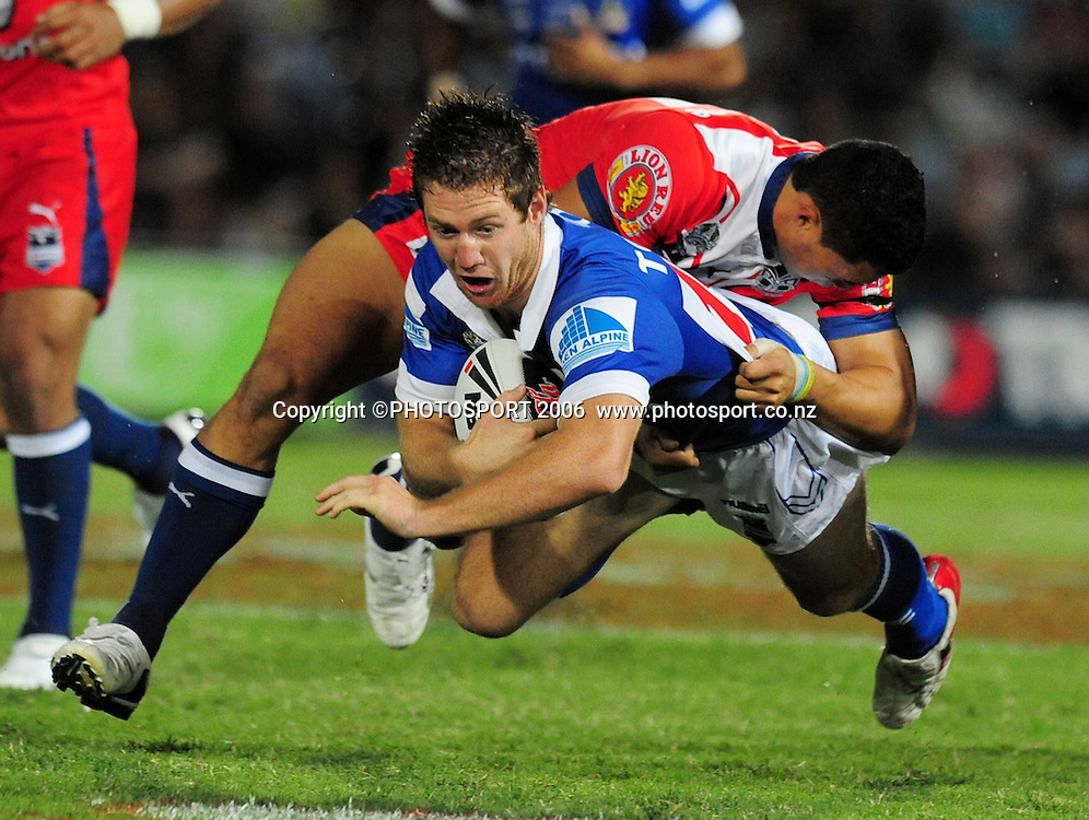 North Queensland Cowboys against the New Zealand Warriors at Dairy Farmers Stadium. Mathew Bartlett gets airborne