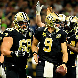 Oct 30, 2016; New Orleans, LA, USA; New Orleans Saints quarterback Drew Brees (9) celebrates with teammates after a touchdown against the Seattle Seahawks during the second quarter of a game at the Mercedes-Benz Superdome. Mandatory Credit: Derick E. Hingle-USA TODAY Sports