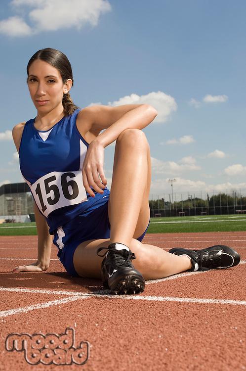 Female track athlete stretching
