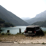 a car for the dead abandoned on a mountain.There are several arguments about the derivation of the name  &quot;Montenegro&quot;, one of these relates to dark and deep forests  that once covered the Dinaric Alps, as it was possible to see them from the sea. <br /> Mostly mountainous with 672180 habitants on an area of 13812 Km&sup2;, with a population density of  48 habitants/Km&sup2;. <br /> It borders with Bosnia, Serbia, Croatia, Kosovo and Albania but  Montenegro has always been alien to the bloody political events that characterized Eastern Europe in recent decades. <br /> From 3 June 2006, breaking away from Serbia, Montenegro became an independent state. <br /> In the balance between economy devoted to sheep farming and a shy tourist, mostly coming from Bosnia and Herzegovina, Montenegro looks to Europe with a largely unspoiled natural beauty. <br /> Several cities in Montenegro, as well as the park Durmitor, considered World Heritage by UNESCO but not yet officially because Montenegro has yet to ratify the World Heritage Convention of UNESCO.