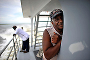 The state of Georgia's Department of Natural Resources operates the only public access ferry used by residents, employees and visitors to the African Geechee-Gullah community of Hog Hammock on Sapelo Island. Property owners are facing higher taxes, and fees from the county tax collector threatening an already fragile community of Hog Hammock. (Stephen Morton for The New York Times)