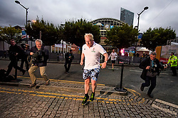 © Licensed to London News Pictures. 02/10/2017. Manchester, UK. Foreign secretary BORIS JOHNSON seen being chased by photographers and camera men while  running on the morning of the second day of the Conservative Party Conference. The four day event is expected to focus heavily on Brexit, with the British prime minister hoping to dampen rumours of a leadership challenge. Photo credit: Ben Cawthra/LNP