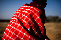 A Masai warrior guide searches for big game on the open plains of Kenya.