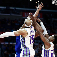 13 January 2018: LA Clippers guard Tyrone Wallace (12) goes for the basket against Sacramento Kings guard Vince Carter (15) and Sacramento Kings guard Buddy Hield (24) during the LA Clippers 126-105 victory over the Sacramento Kings, at the Staples Center, Los Angeles, California, USA.