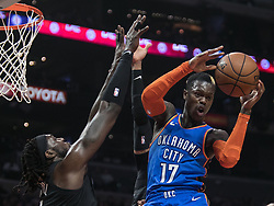 March 8, 2019 - Los Angeles, California, United States of America - Montrezl Harrell #5 of the Los Angeles Clippers tries to block a shot by Dennis Schroder #17 of the Oklahoma Thunder during their NBA game on Friday March 8, 2019 at the Staples Center in Los Angeles, California. Clippers defeat Thunder, 118-110.  JAVIER ROJAS/PI (Credit Image: © Prensa Internacional via ZUMA Wire)