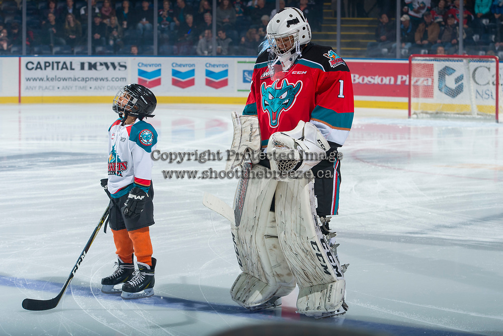 KELOWNA, CANADA - OCTOBER 28: The Pepsi player of the game lines up on the blue line next to James Porter #1 of the Kelowna Rockets against the Prince George Cougars on October 28, 2017 at Prospera Place in Kelowna, British Columbia, Canada.  (Photo by Marissa Baecker/Shoot the Breeze)  *** Local Caption ***