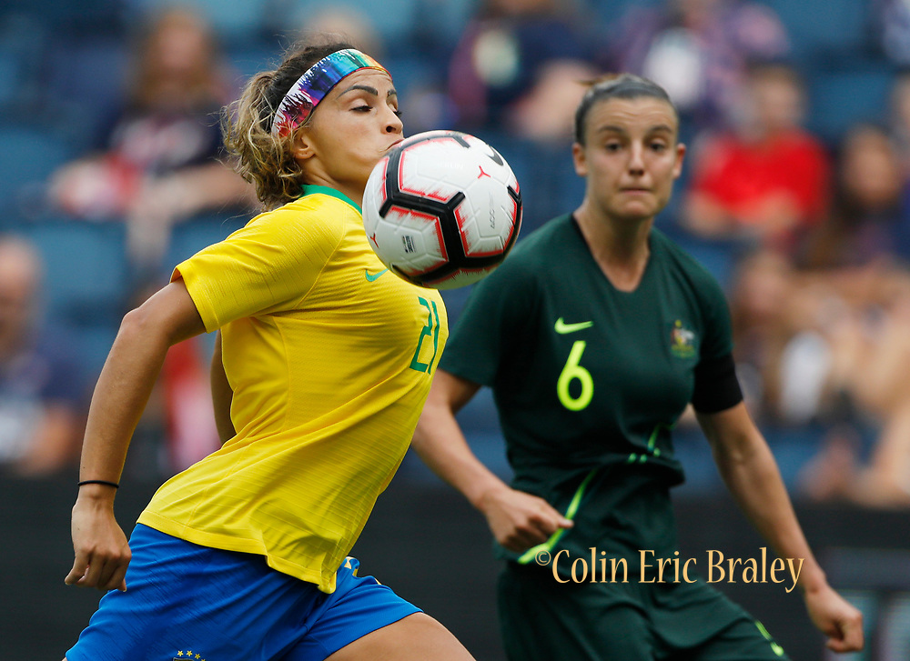Brazil defender Mônica (21) gets control of the ball as Australia midfielder Chloe Logarzo (6) defends during the first half of the Tournament of Nations soccer match in Kansas City, Kan., Thursday, July 26, 2018. (AP Photo/Colin E. Braley)