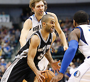 San Antonio Spurs point guard Tony Parker (9) attacks the basket against the Dallas Mavericks at American Airlines Center in Dallas, Texas, on January 25, 2013.  The Spurs went on to win 113-107.  (Stan Olszewski/The Dallas Morning News)