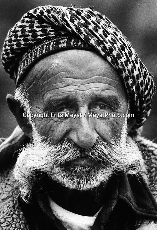 MALUMA, KURDISTAN, IRAQ. A kurdish man who has lost his wits in the war after his whole family was killed in front of his eyes. He is supported by the villagers ©Photo by Frits Meyst/NewsImages